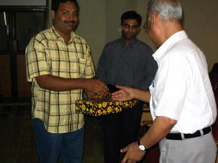 Bharathi receiving the IEEE magazine from Dr. K. P. Mohammed (Principal)