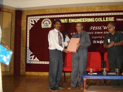 Dr. Srinivasan receiving a momento