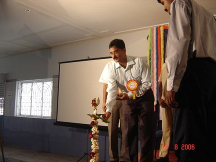 Mr. Atul Anand, IAS lighting the lamp, no, not GNU/Linux, Apache, Mysql, PHP (GLAMP)