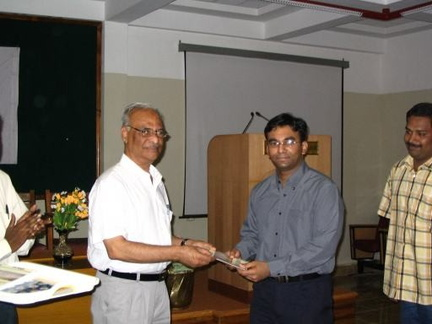 Myself receiving the IEEE magazine from Dr. K. P. Mohammed (Principal)